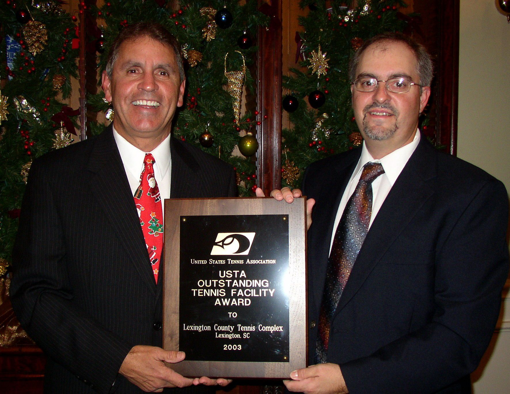 Jorge Andrew and Joel Corley accepting the National Facility of the Year Award