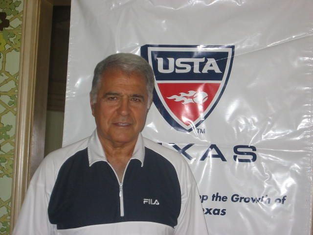 JR in front of USTA Sign