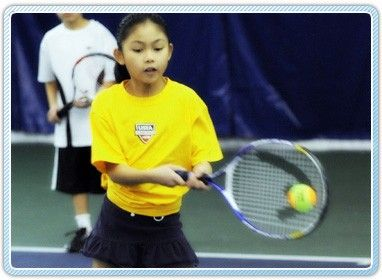 girl hitting forehand