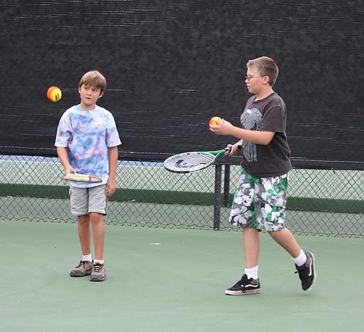 boys bouncing balls