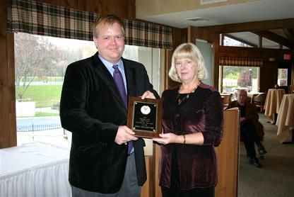 John Montognese, Madison,  accepts the WTA League Player of the Year Award from new DLC, Judy Veloff