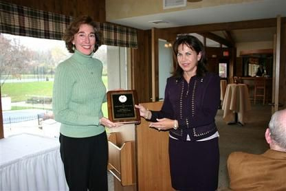 Mary Jo Siebenhaler receives the WTA Organization of the Year Award for Marshfield Tennis Association from Nancy Massart, Awards Chair
