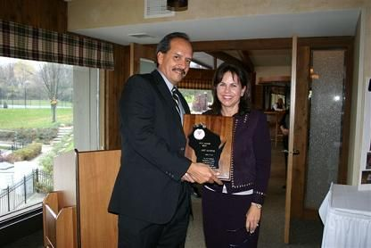 Nancy Massart, Awards Chair presents Art Santos with the WTA Award