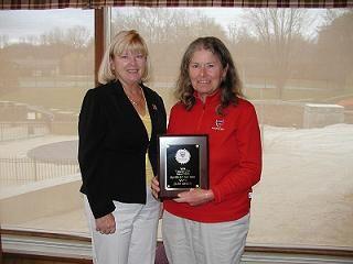Judy Veloff presents Jane Breun with the League Player Award