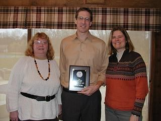 Karen Drecktrah presents Scott Beyer with the League Player Award joined by his wife Debbie