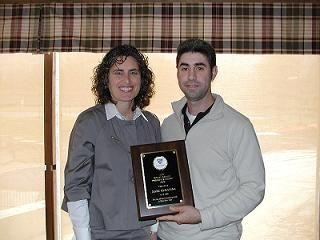 Linda Freedman presents Marc Rukavina with the WTA Rollie Mueller Presidents Award