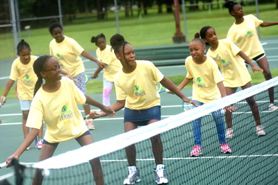 _Girls-from-the-summer-camp-at-Tech-Generation-get-their-first-taste-of-tennis_400