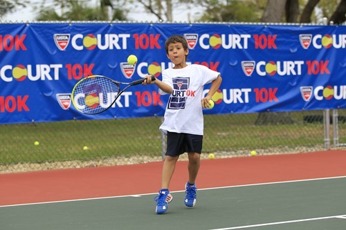 By featuring shorter and lighter racquets, slower-bouncing balls, smaller courts and simplified scor