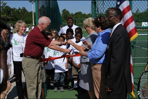 USTA Florida Executive Director, Doug Booth, does the honors
