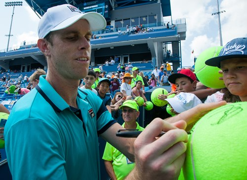 Sam Querrey signed autographs for fans after his victorious match