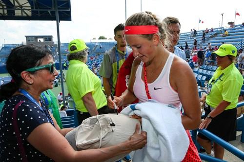Victoria Azarenka signing an autograph for a fan after her match.