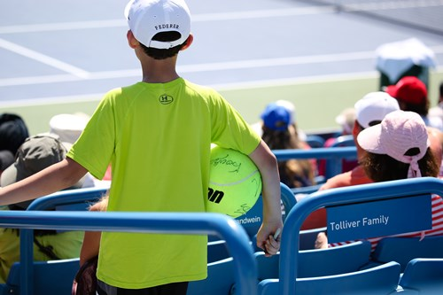A young fan watches over Federer's practice