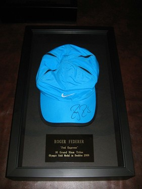 Federer's hat, signed and framed.