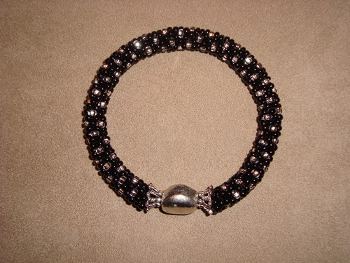 Women's black beaded handmade bracelet, by Kathleen Autrey.