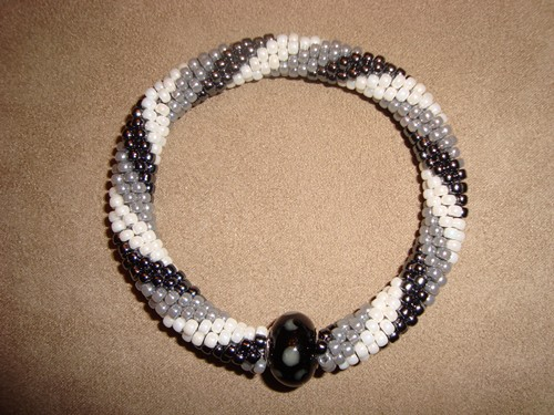 Women's black/white/grey beaded handmade bracelet, by Kathleen Autrey.
