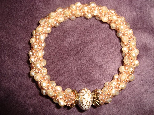 Women's gold beaded handmade bracelet, by Kathleen Autrey.