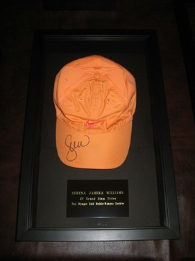 Serena's hat, signed and framed.