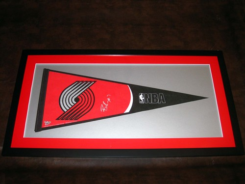 Blazer pennant signed by Brandon Roy and framed.