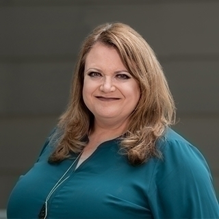 Headshot of Angela Curtis.
