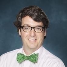 Headshot of Clay Cauthen.