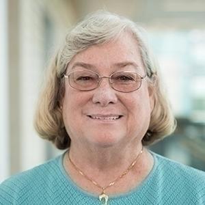 Headshot of Sue Cox.