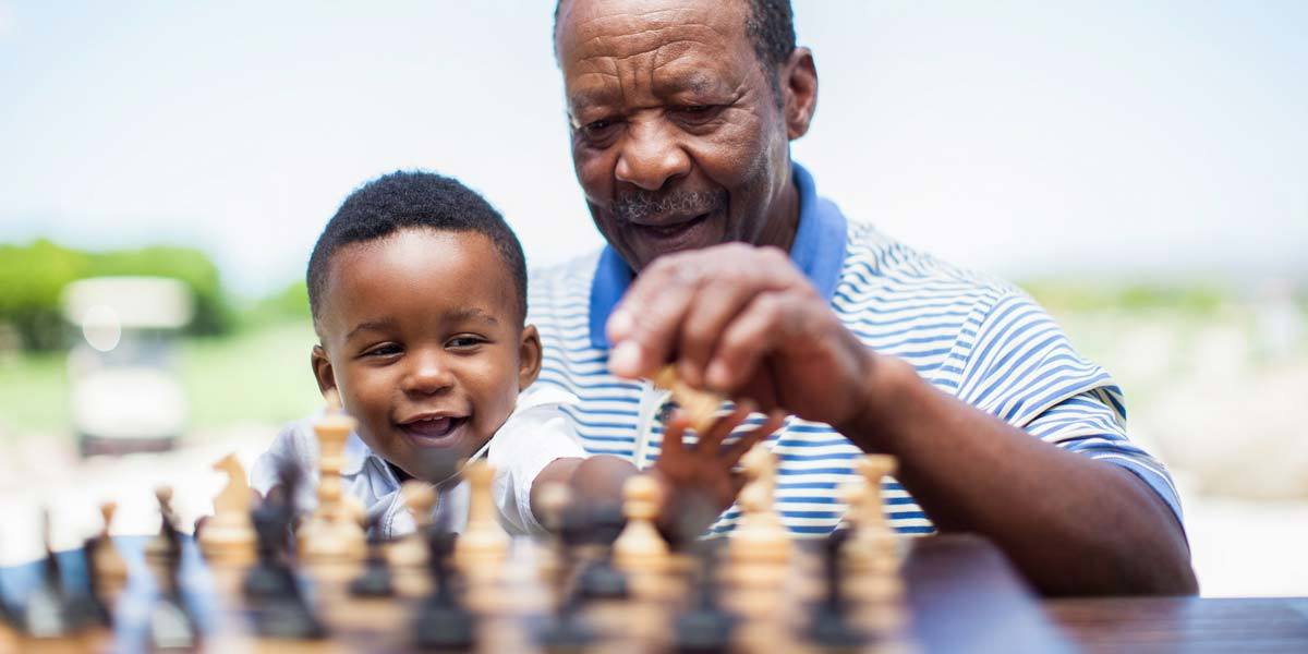 Man and grandson playing chess