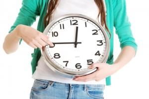 Student holding clock