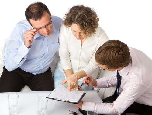 Counselor going over paperwork with couple.