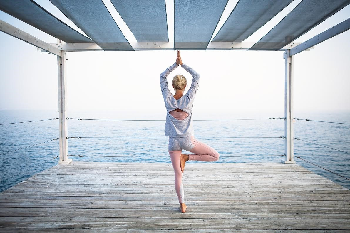 Woman practices yoga. Exercise is an important component of preventative health.