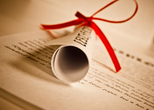 A diploma tied with a ribbon