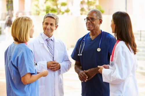 Nurses talking to one another