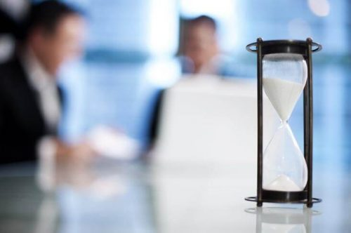 A meeting with an hourglass to keep time.