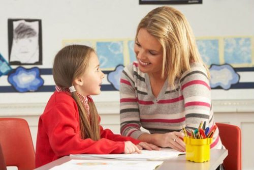 An elementary school counselor helps a student identify her interests and strengths.
