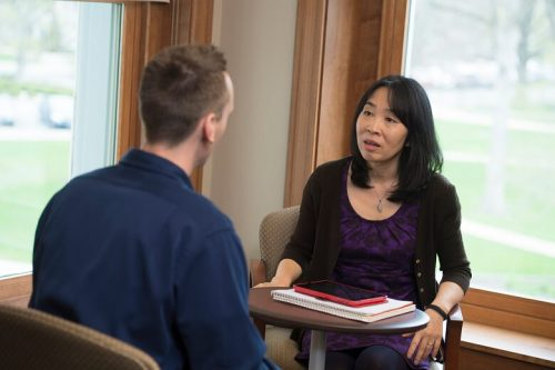 A clinical mental health counselor speaks with a client.