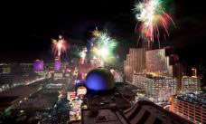 Fireworks over tall buildings at night