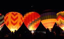 Image of hot air balloons at night