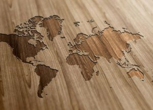 Map of the world etched in wood represents the interconnectedness of the world and our public health vs. global health.