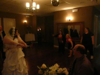 Unplanned, guest-insisted bouquet toss #1.  Have to move cuz I can see the gals in a reflection.