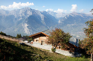 Swiss chalet set in majestic landscape