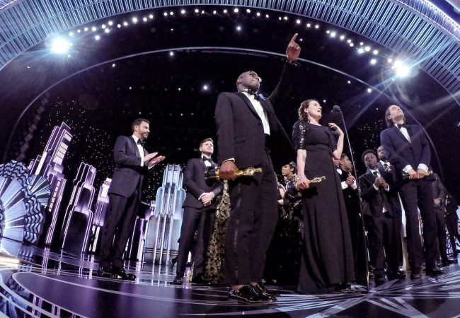 """Adele Romanski, Berry Jenkins, and Jeremy Kleiner accept the Oscar® for Best motion picture of the year, for work on """"Moonlight"""" with host Jimmy Kimmel during the live ABC Telecast of The 89th Oscars® at the Dolby® Theatre in Hollywood, CA on Sunday, February 26, 2017."""