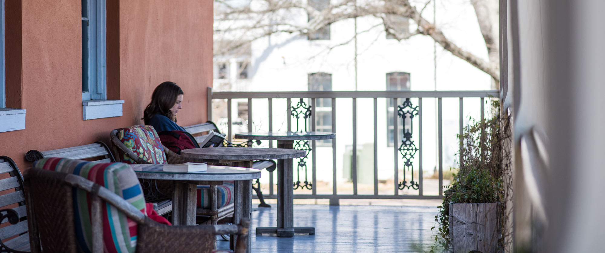 Reading a book on the Square Books Balcony, Oxford Mississippi