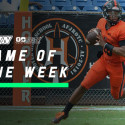 Hoover High School Quarterback rolls out of the pocket to throw the football