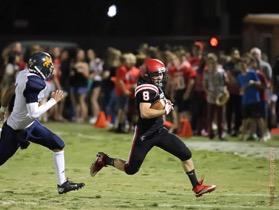 Titan Varsity Football Takes HoCo Game 35-6