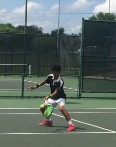 Brian Nguyen handles a volley