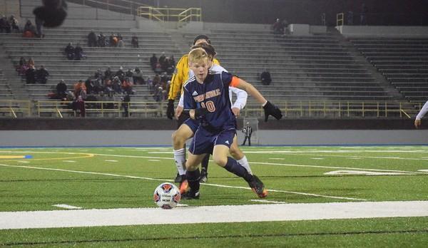 Powers Catholic High School Boys Varsity Soccer beat Richmond High School 2-1