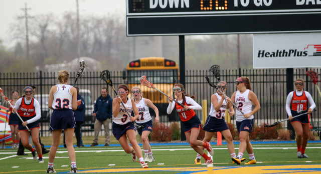 Powers Catholic High School Girls Varsity Lacrosse beat Midland Dow H.S. 11-8