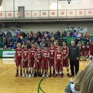 The 7th Grade boy's basketball team immediately following their championship victory over LCC