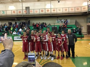The Red Devils 8th grade boy's basketball team celebrating their dramatic victory over Mogadore on the Cats home court