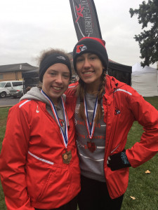 Shelbie Truett (Left) and Madelynn Frey celebrate at the Regional Meet in Troy after they qualified for the State Championship meet.