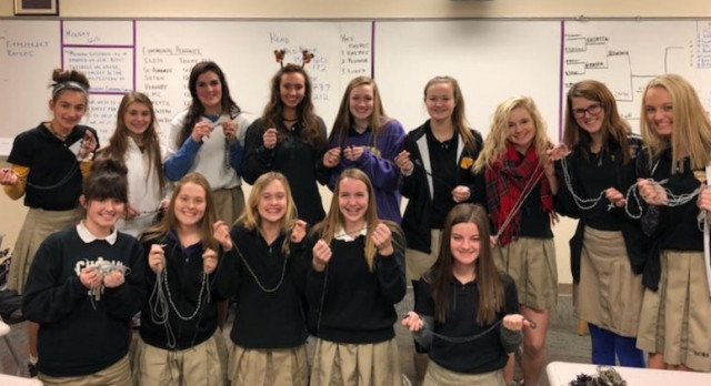 Cheerleaders make Rosaries for men & women in the Military